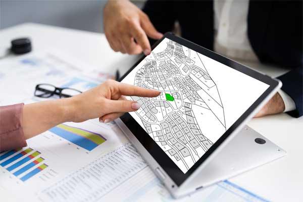 NTB Survey Discussing Site Plans At A Desk
