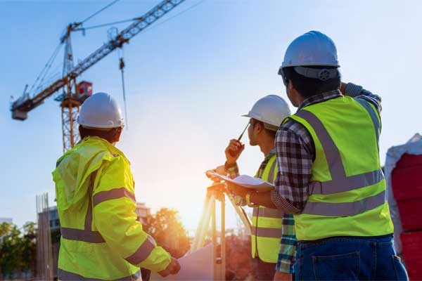 NTB-Survey-Surveyors-On-Building-Site-With-Crane-Small